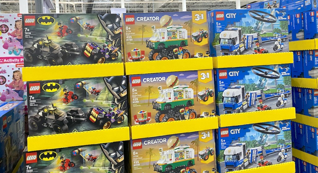 lego city and creator boxes stacking in piles on store floor