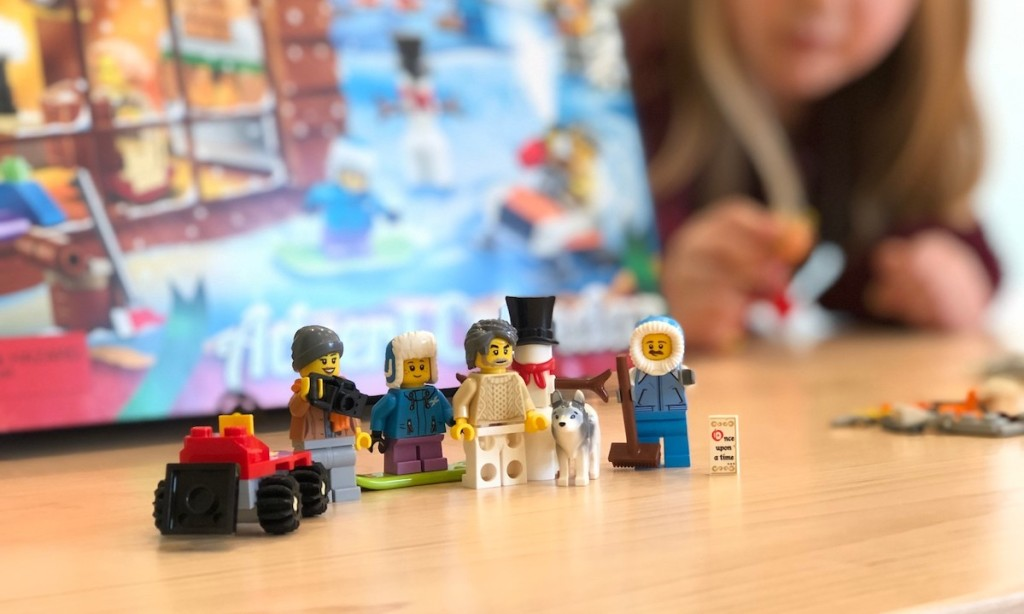 lego people sitting in front of advent calendar box