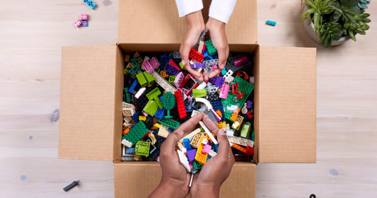 hands putting LEGOs in box