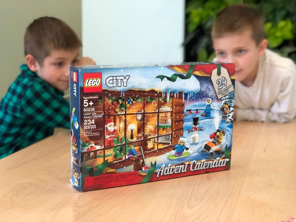 two boys sitting by LEGO City Advent Calendar