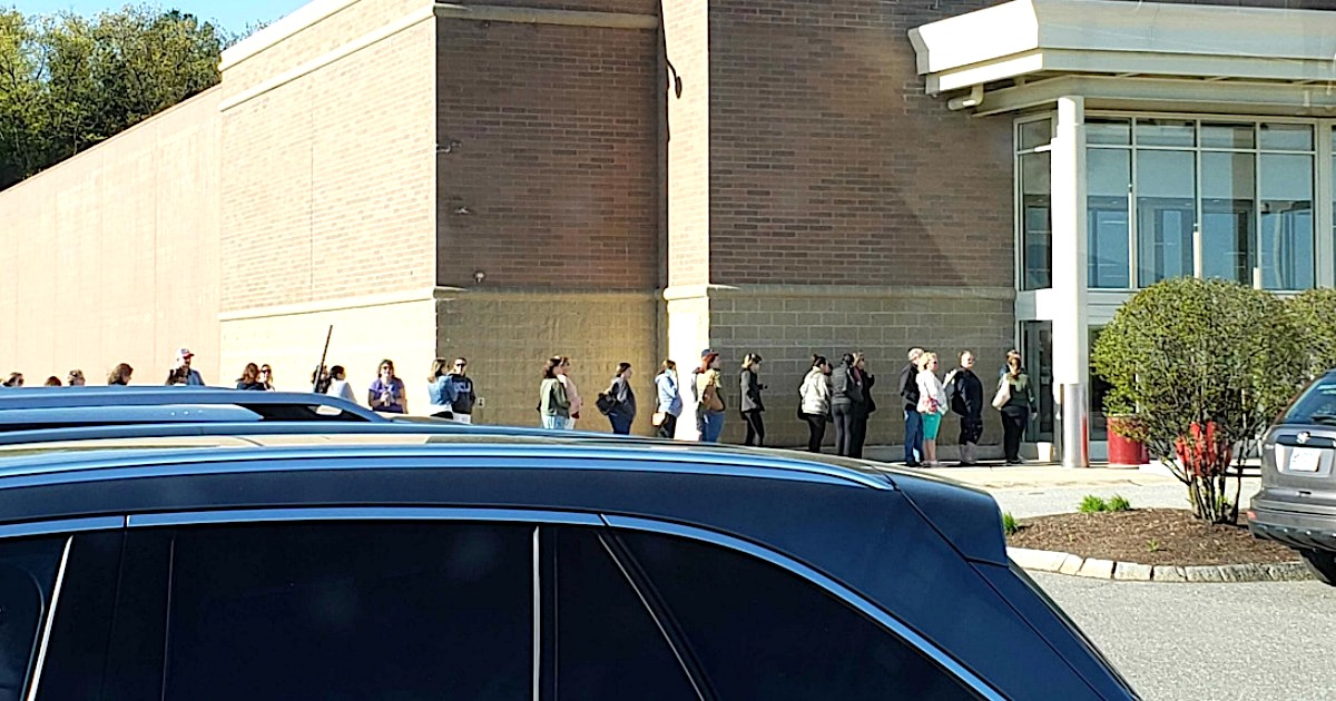 long line waiting outside store on Thanksgiving day