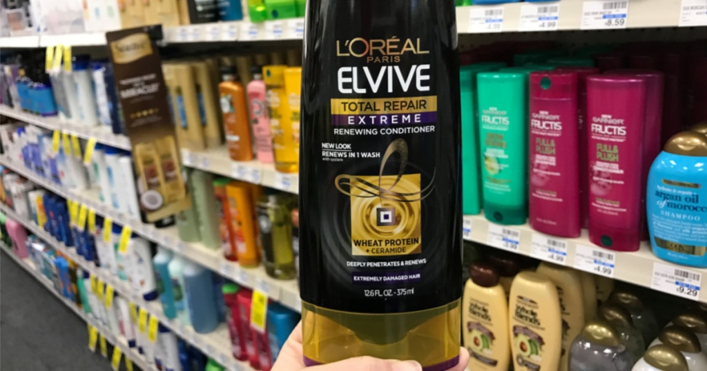 hand holding L'Oreal Elvive Conditioner in store