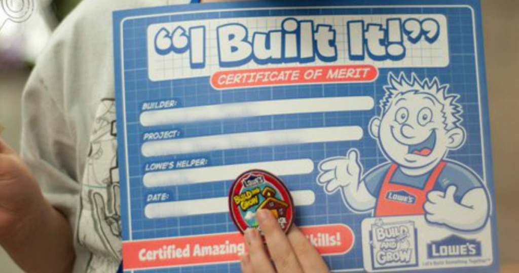 """kid holding Lowe's """"I Built It!"""" certificate and pin"""