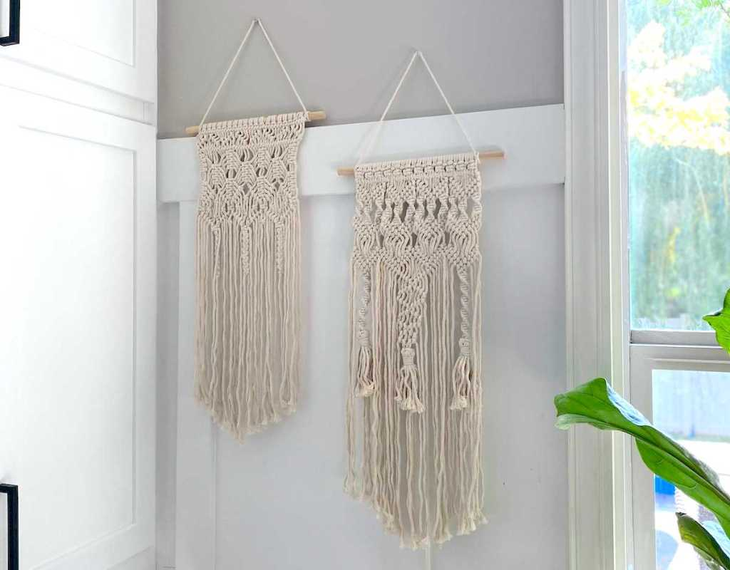two macrame hanging wall pieces on white wall