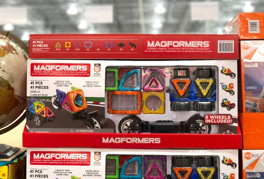 magformers toys in boxes stacked at store