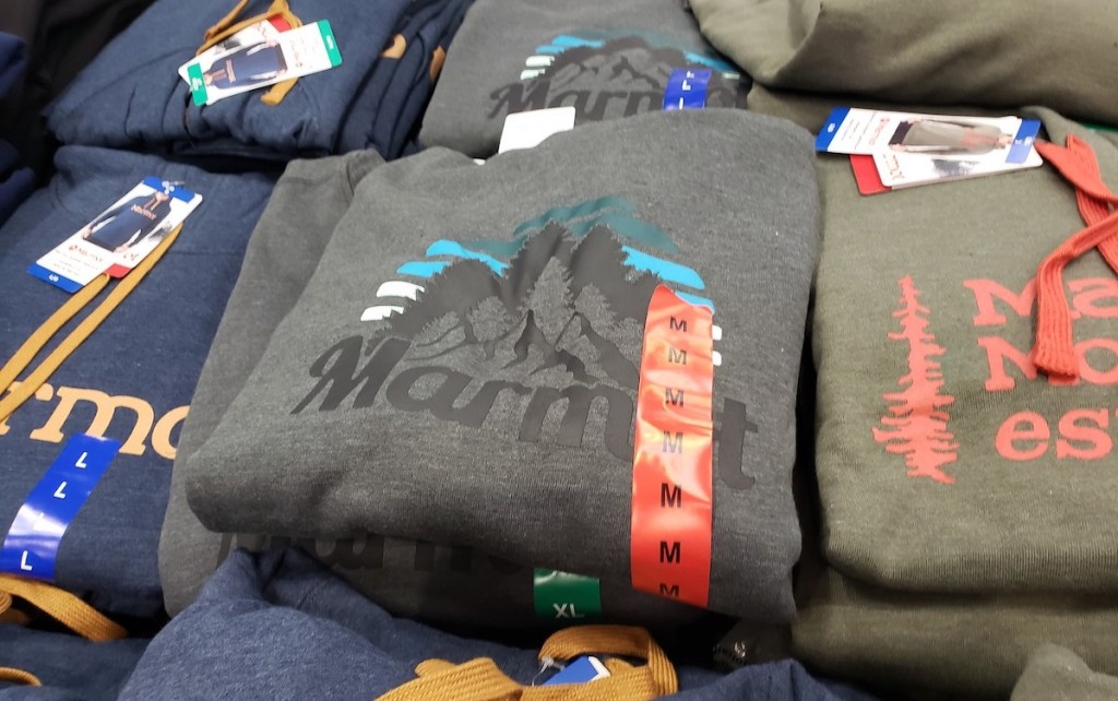 marmot hoodies sitting in pile with tags