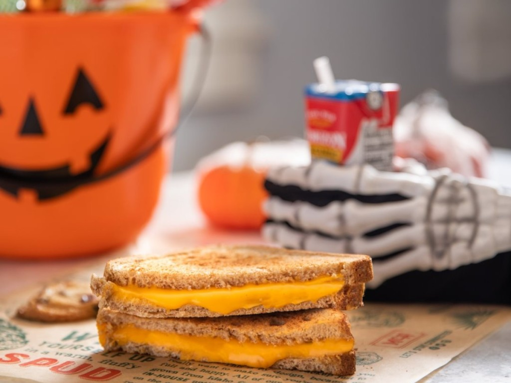 grilled cheese sandwich with skeleton hand reaching for milk