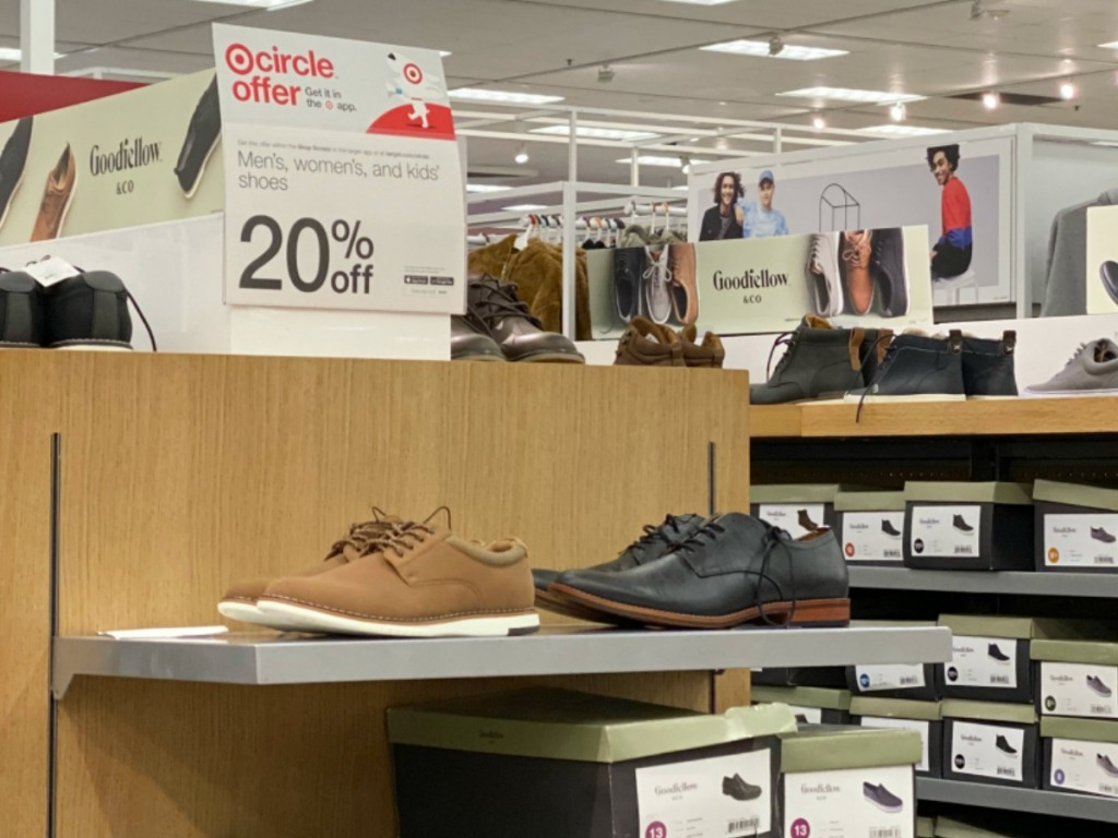 mens shoes on display in store aisle