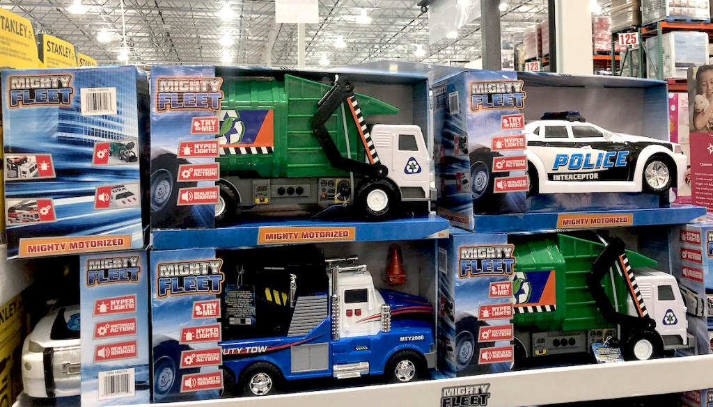 mighty fleet trash trucks police cars and other toys stacked in boxes