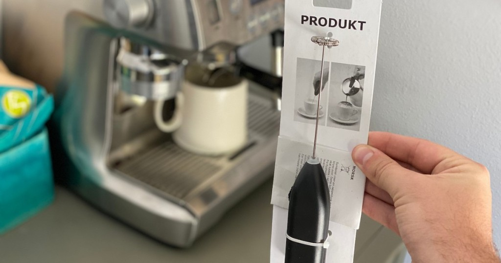 hand holding ikea milk frother in packaging