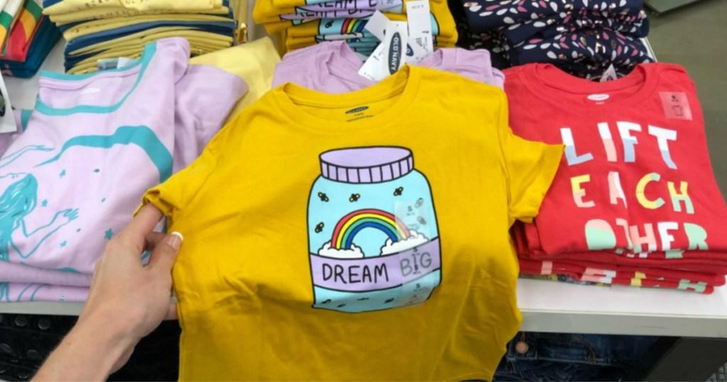 hand holding dream big shirt in store