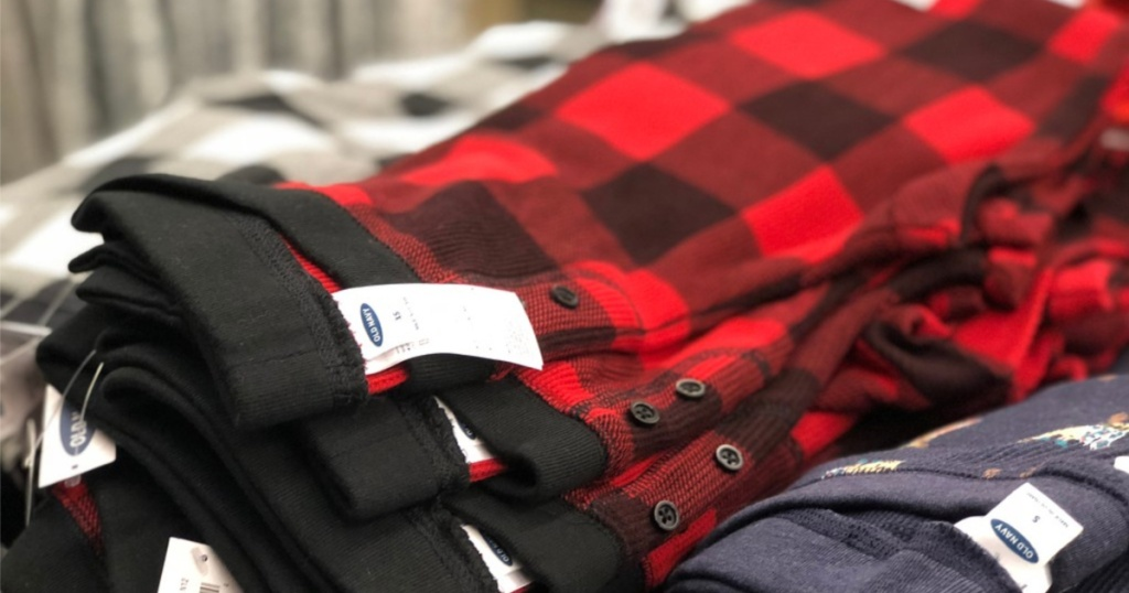 red and black flannel pajama pants laid out in store