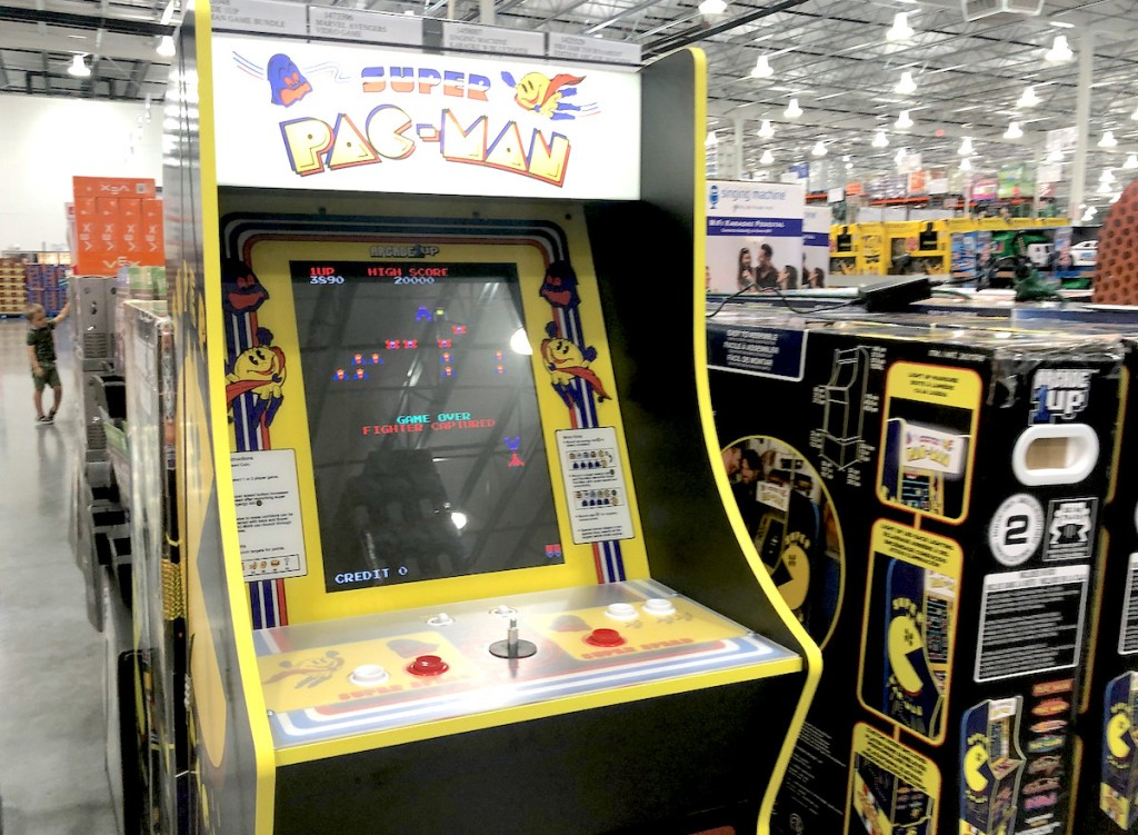 pacman arcade game sitting in store