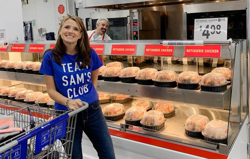 Paige by rotisserie chickens at Sam's Club