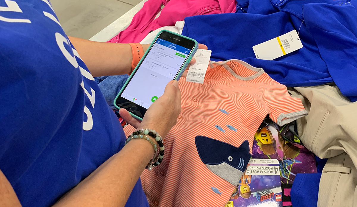 Paige using the Scan and Go app at Sam's Club