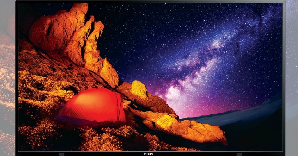 tv with picture of rocks and ocean at night