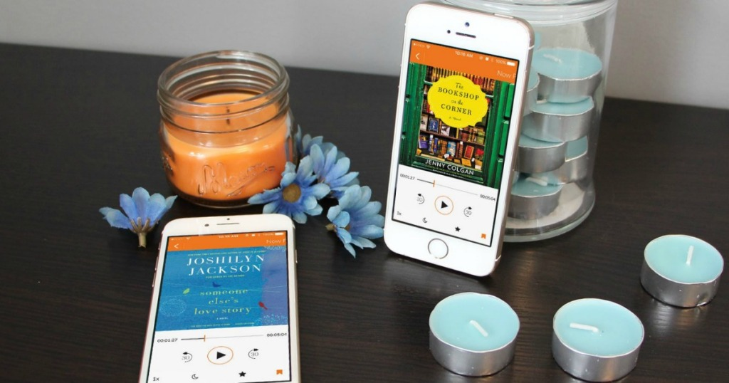 phones showing Audiobooks app on table with candles and flowers