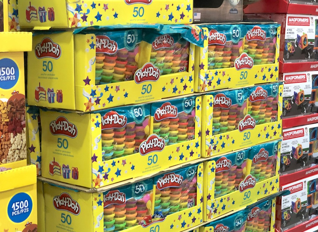 yellow stacks of play doh boxes on store floor