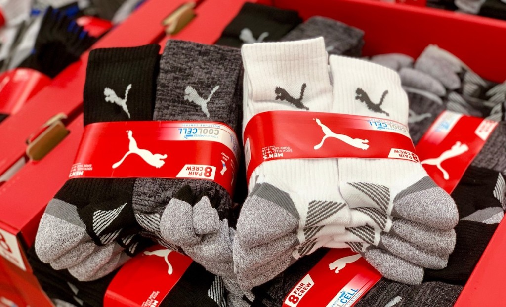 black gray white puma crew socks in store bin