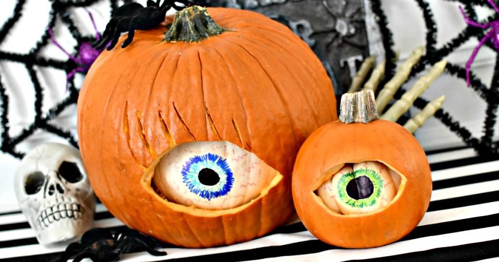 pumpkin inside of a pumpkin carved eyes