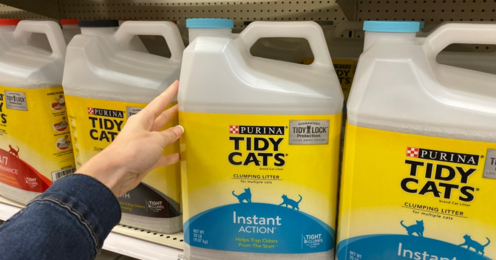 hand reaching for purina tidy cats on shelf