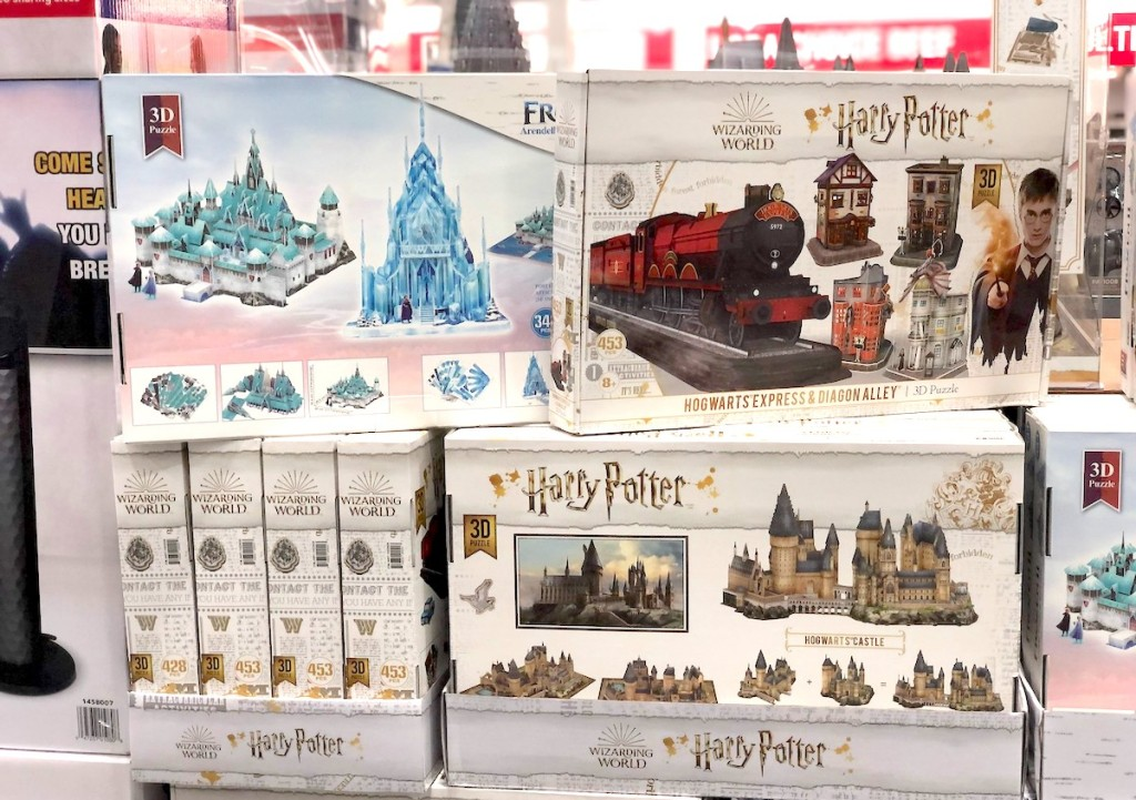 frozen and harry potter 3d puzzles stacked on store shelf