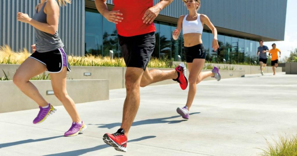 people running on sidewalk