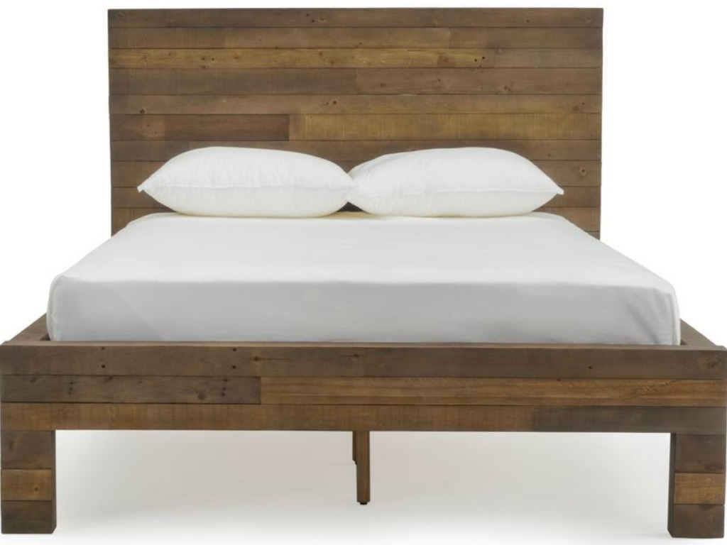bed in wood with mattress and pillows