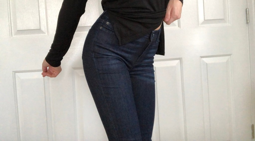 woman wearing amazon jeans and black shirt