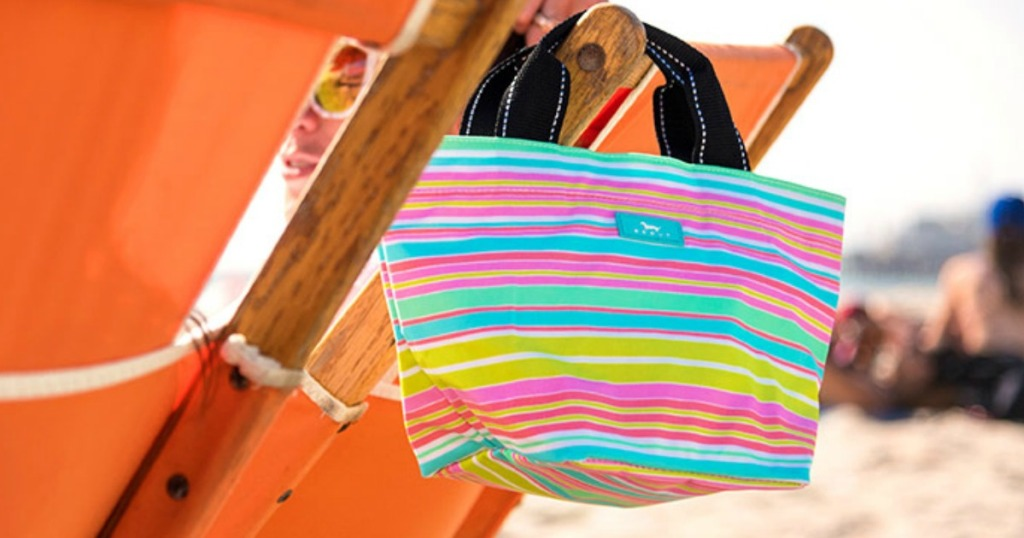 scout daytripper tote hanging on beach chair