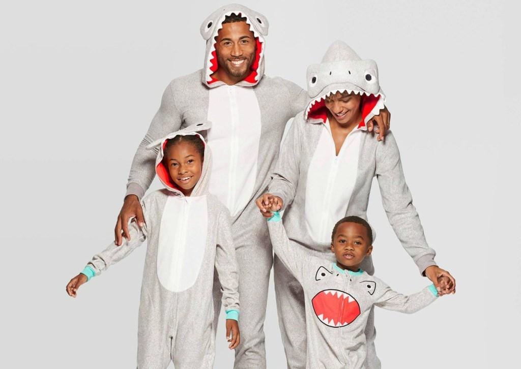 family wearing matching shark pajamas