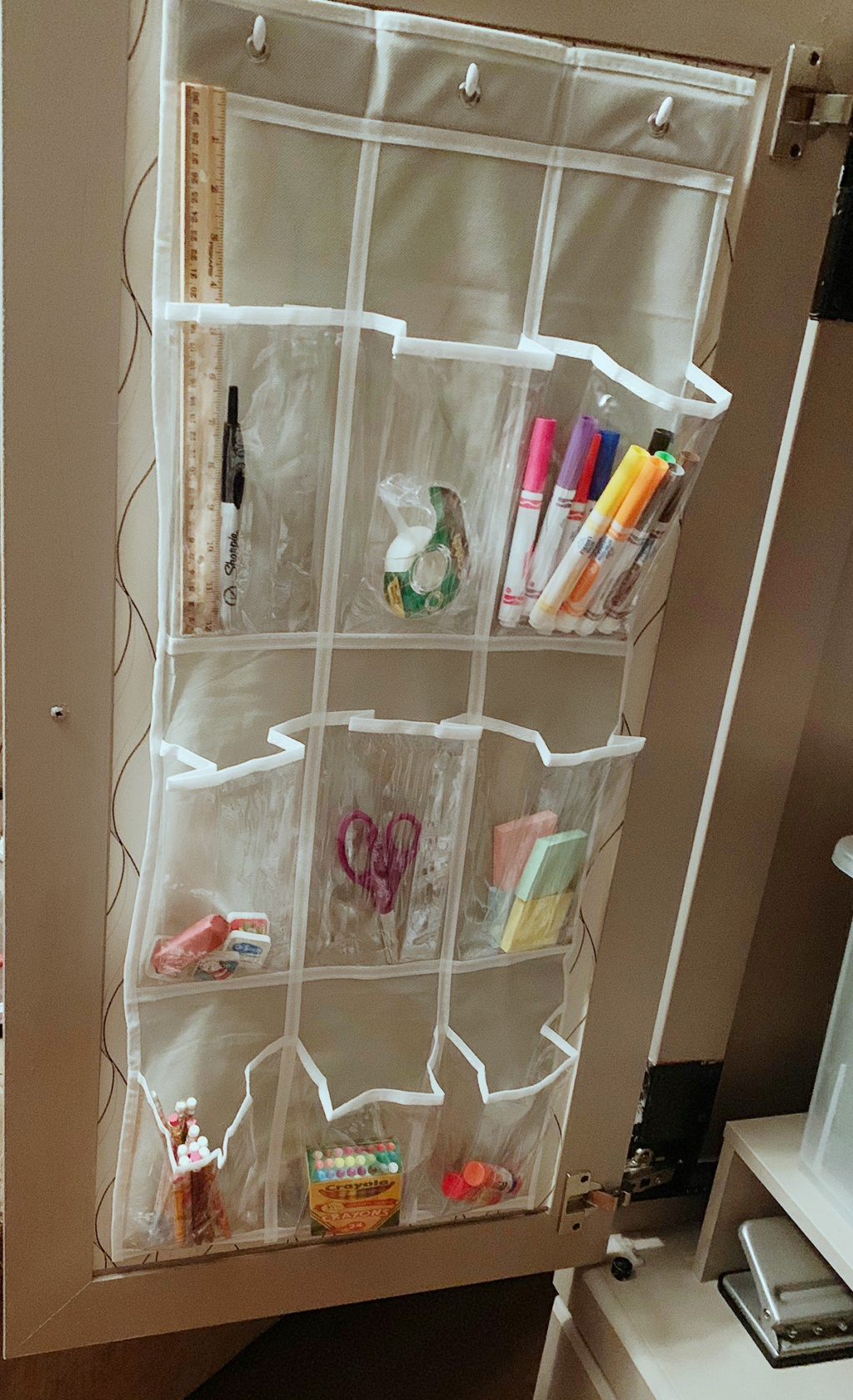 Over the door shoe hanger used for markers, pencils, and other supplies organization