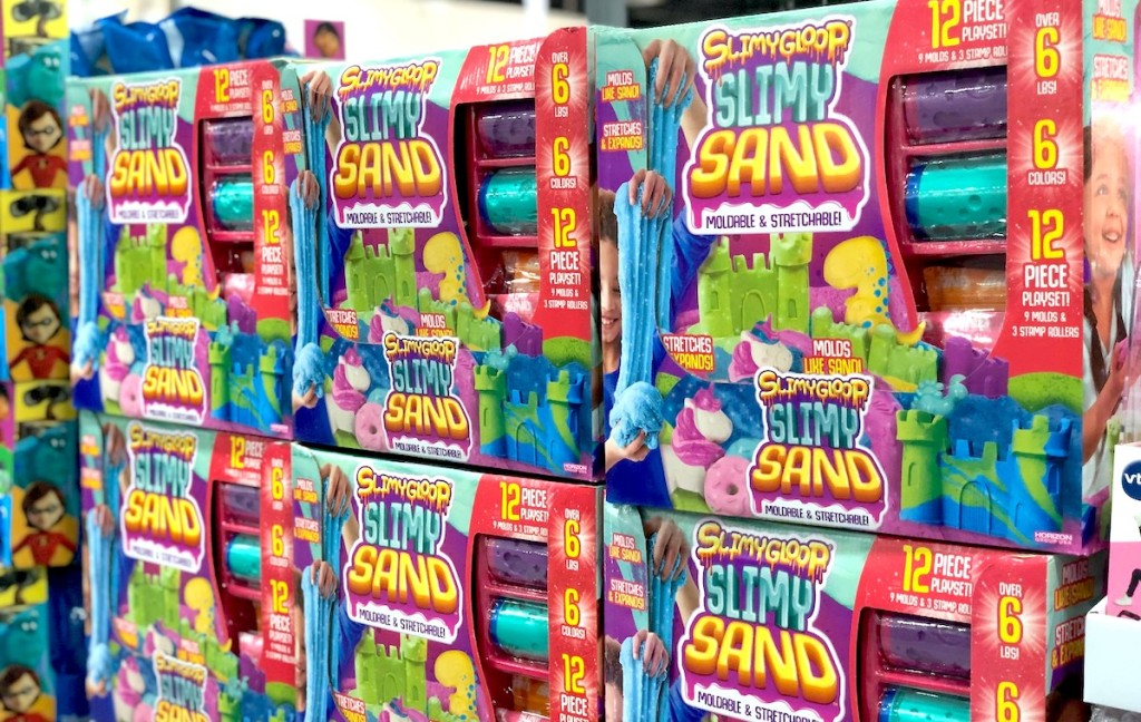 stacks of slimy sand toys in boxes in store