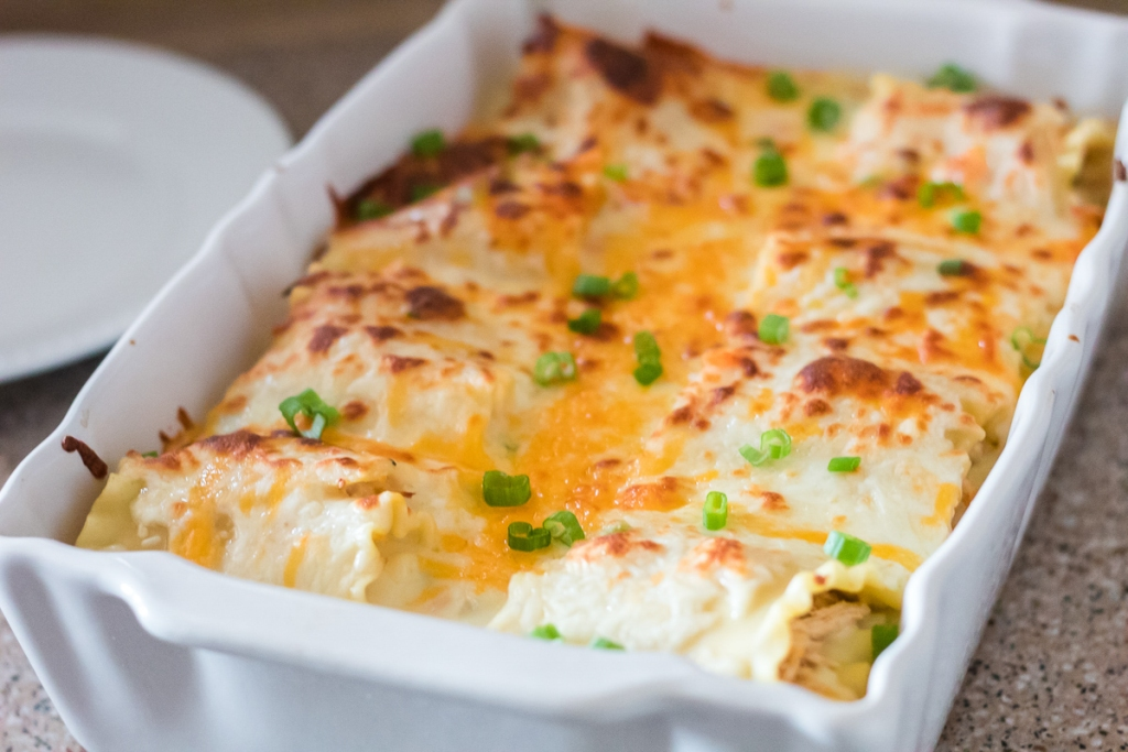 casserole dish of spicy chicken lasagna roll-up