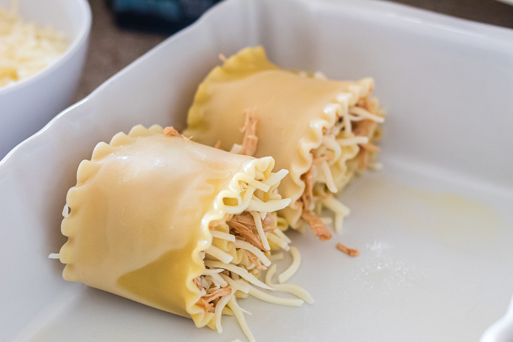 two chicken roll-ups in casserole dish