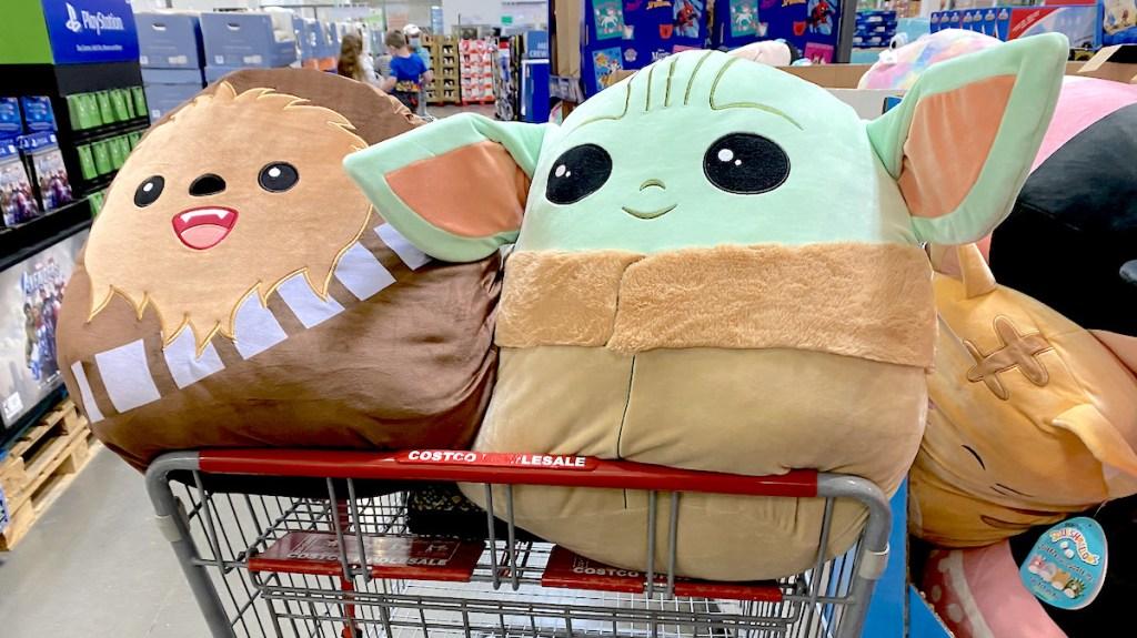 star wars plush dolls sitting in large store cart