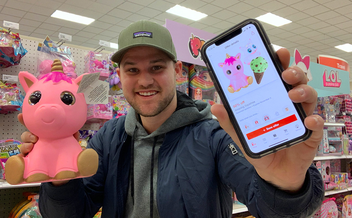 man using Target Circle app for toy discount
