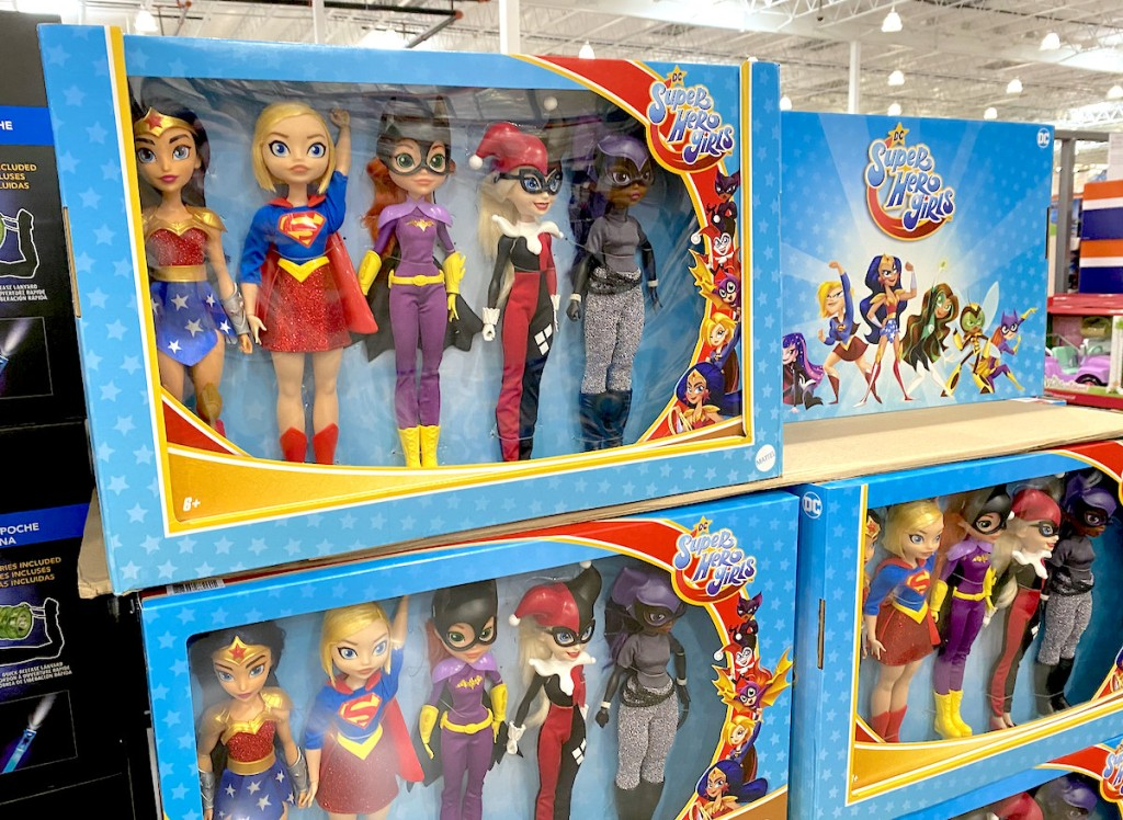 super hero girl dolls dressed up in blue boxes stacked on top of each other