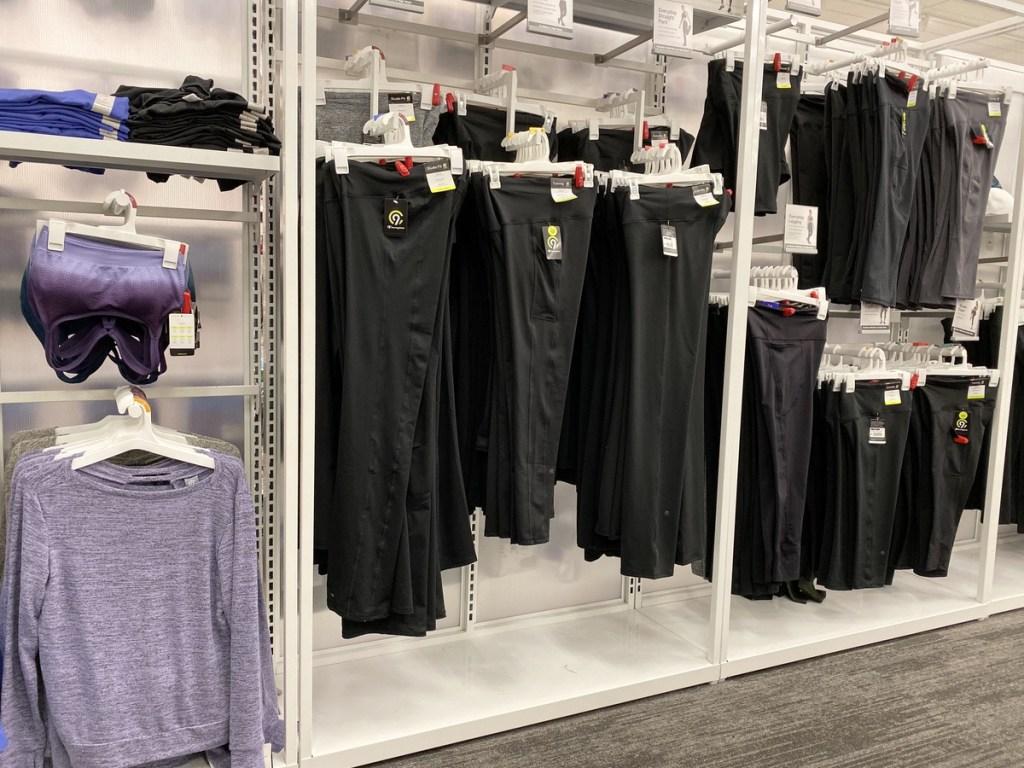 black yoga pants hanging in store