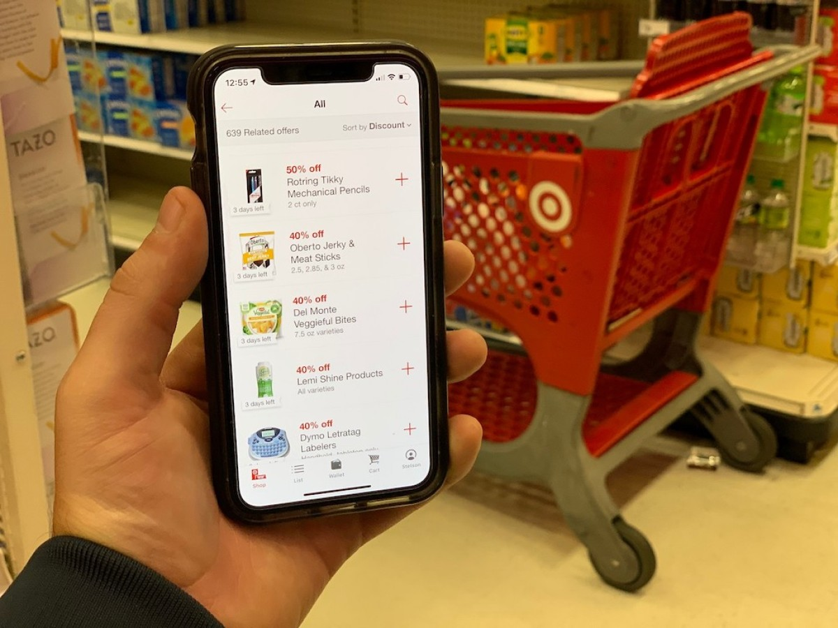 holding iPhone with Target circle household offers
