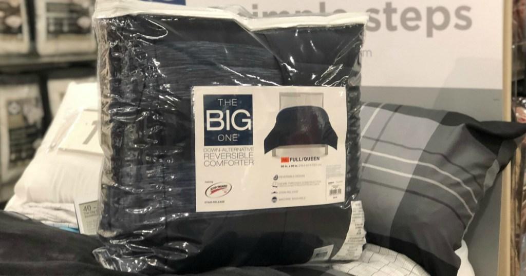 blanket in bag sitting on bed in store display