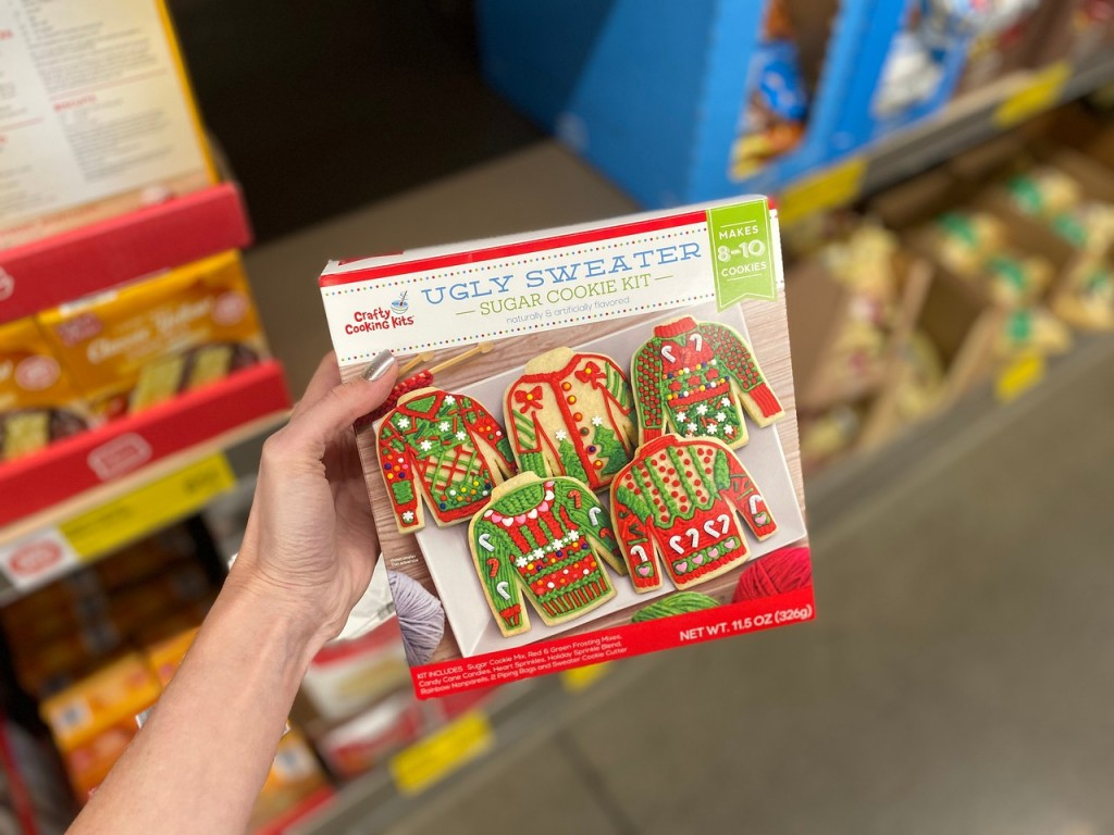 ugly sweater cookie kit held up in ALDI store aisle
