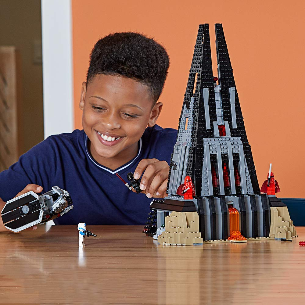 Boy playing with Darth Fortress
