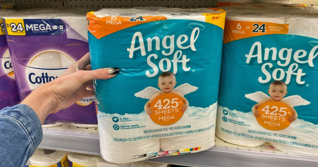hand holding pack of Angel Soft toilet paper
