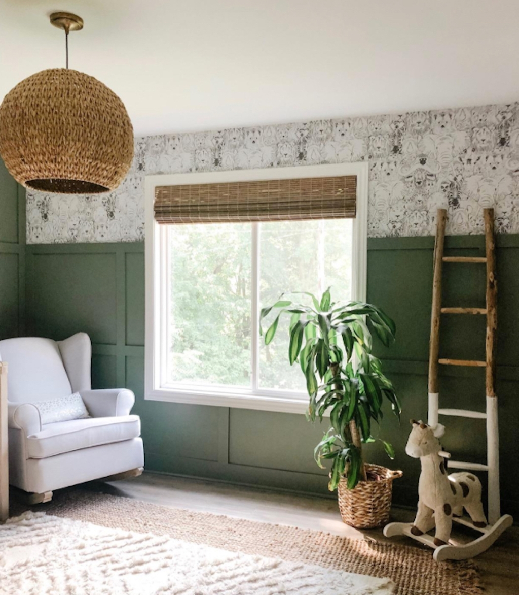 green and white nursery with ladder and rocking chair