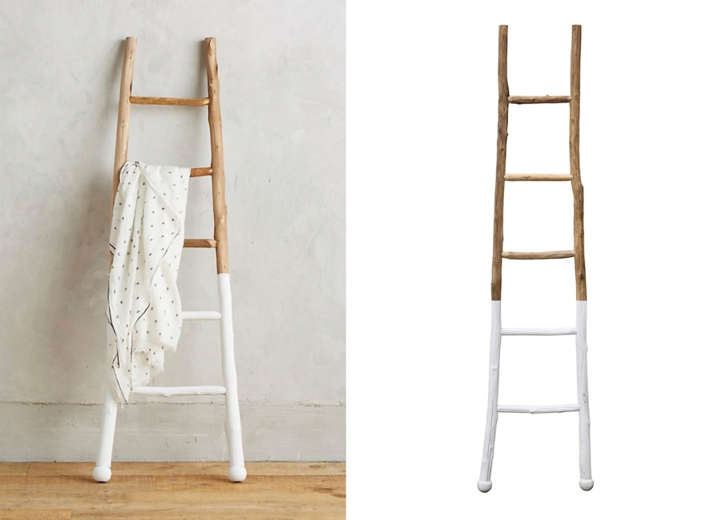 two white dipped wood ladders with blanket