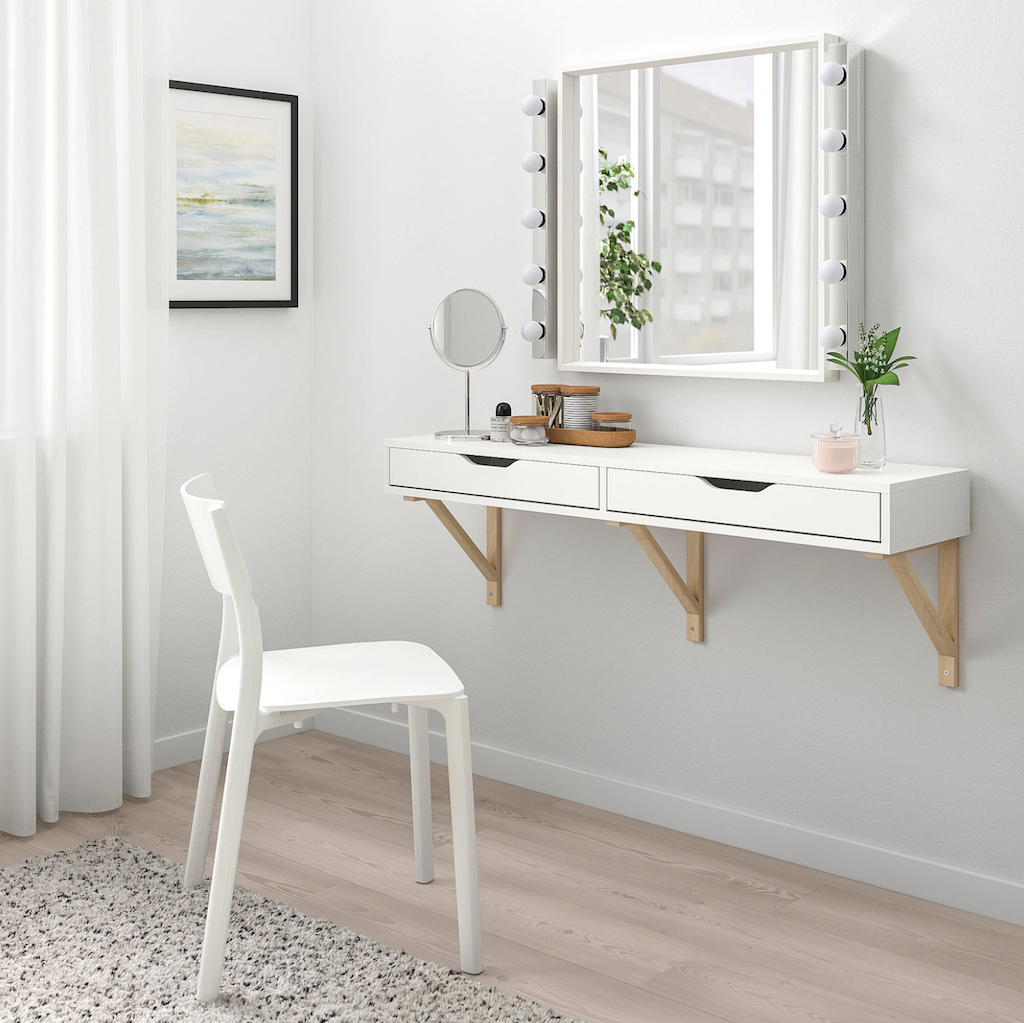 IKEA vanity wall shelf with chair and lighted mirror