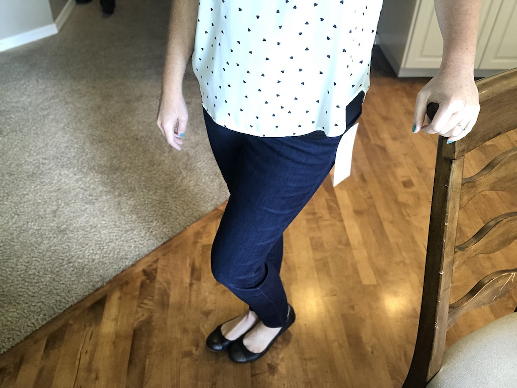 woman standing with skinny jeans and flats
