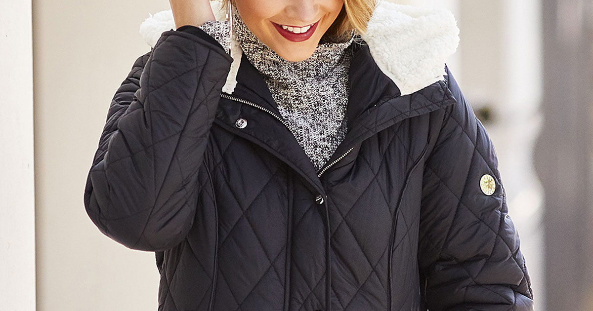 woman wearing a black quilted winter jacket