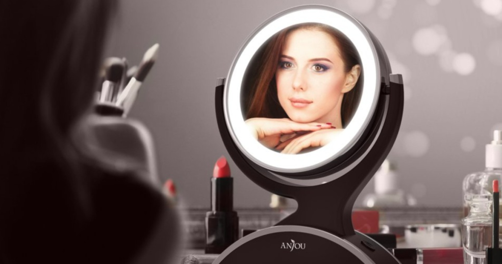Woman's reflection in Anjou LED Lighted Mirror